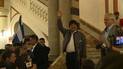 Morales and supporters celebrate narrow victory in first round of presidential polls