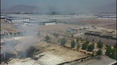 Drone images of Chile torched factory where 5 people died
