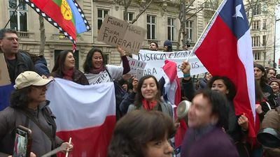 Protesters in Paris gather outside Chilean embassy