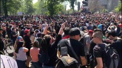 Thousands gather in central Santiago square over transport price hike