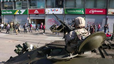 Soldiers patrol Santiago streets after violent weekend
