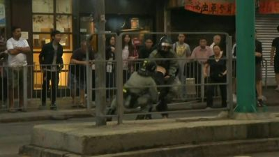 Tensions rise at protest in Hong Kong's Tuen Mun district