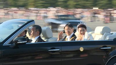New Japanese emperor treats crowds to rare open-top car imperial parade