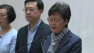 HK leader says government won't yield to escalating violence