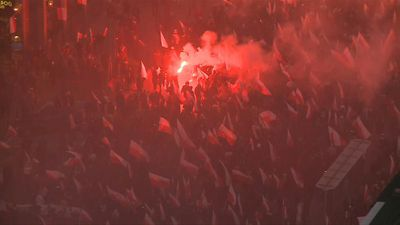 Polish far-right groups march, filling Warsaw streets with red smoke