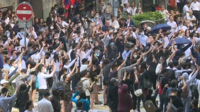 Office workers in HK's business district show solidarity to protest movement