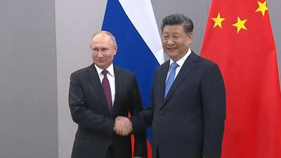 Presidents of Russia and China shake hands ahead of BRICS summit