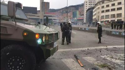 Bolivian police stand guard after violent clashes in La Paz