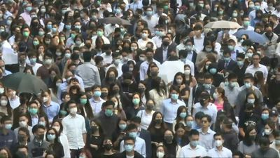Hong Kongers march during lunch time in business district