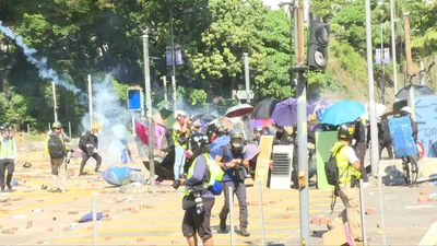 Hong Kong protesters clash with police at key campus battleground
