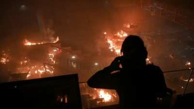 Fire rages at Hong Kong campus entrance as protesters fend off police: AFP