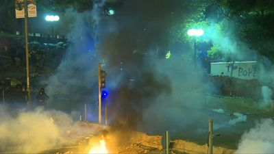 HK riot police and protesters clash at university campus