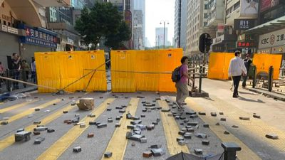 Hong Kong protesters create barricades, place bricks in Kowloon
