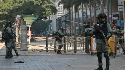 HK police clear barricades near campus protest siege