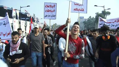 Iraqi anti-government demonstrators react to Iran riots