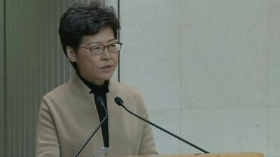 Hong Kong leader says campus protesters must surrender
