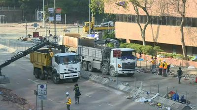 Excavators start clearing debris as diehards hold out at HK campus