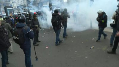 Police and rioters clash in Paris during demonstration against pension reform