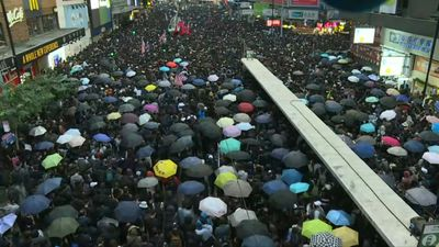 Tens of thousands hit streets of Hong Kong for huge rally