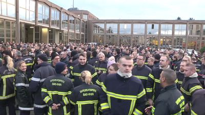 Firefighters demonstrate to protest violence and abuse
