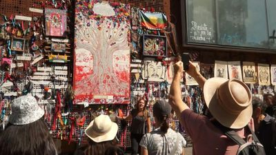 Chilean guides explain protests to tourists through street art tour