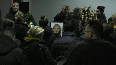 Ukrainians pay respects to the victims of downed plane