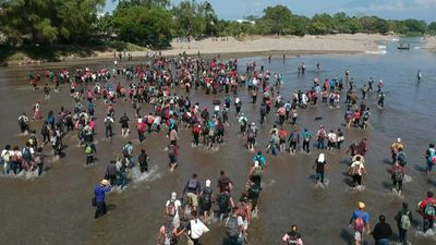 Migrants wade across river, crossing into Mexico from Guatemala