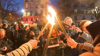 French union holds torch-lit protest in Paris against pension reform