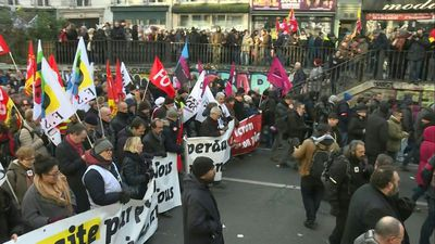 Protesters march in Paris against pension reform