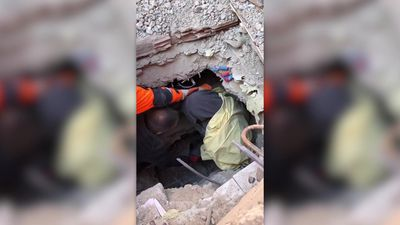 Turkish aid workers pull woman from collapsed building
