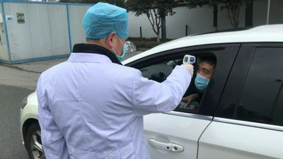 China virus: Makeshift temperature checkpoint in Wuhan