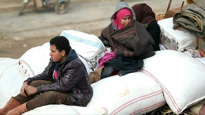 Residents of northern Syria flee bombardment by regime forces