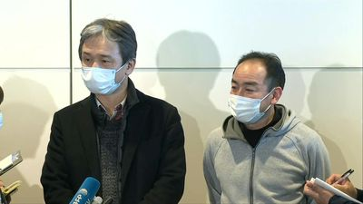 Images of passengers speaking to media after Japan evacuation plane from Wuhan lands in Tokyo