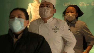 Hotel staff in Wuhan exercise daily to keep virus at bay