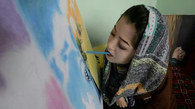 Afghan artist brushes aside disability to open arts centre