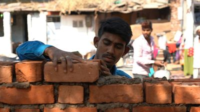 Indian city builds wall to hide slum for Trump visit