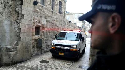 Israeli forces gather where a suspect armed with knife was killed