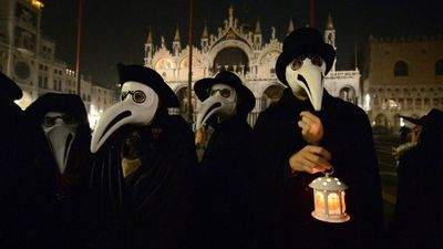 Venice carnival: Procession featuring 'plague doctor' masks
