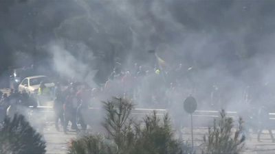 Protesters throw stones at riot police as Lesbos migrant camp protests intensify