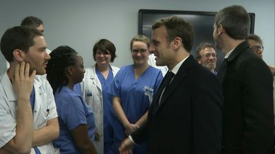 French president visits hospital where first French coronavirus victim died
