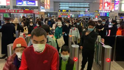 Hundreds arrive in Wuhan as China eases lockdown restrictions