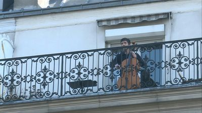 Coronavirus: Cellist Camilo Peralta performs on his balcony in Paris