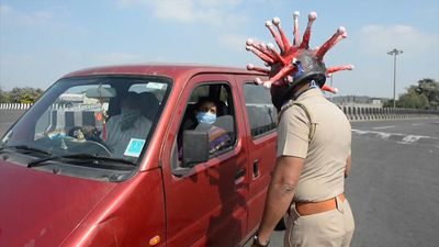 Indian cop confronts coronavirus head-on with handmade helmet