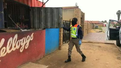 Coronavirus: police close down shops in Soweto, South Africa