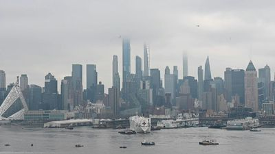 Images of Manhattan's skyline with USNS Comfort docked at Pier 90