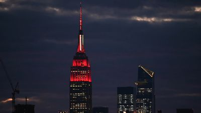 Empire State Building shines red and white to honor healthcare workers