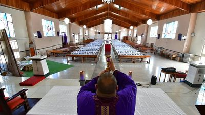Costa Rican priest fills pews with photos of parishioners during the coronavirus outbreak