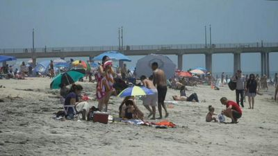 California locals sunbathe and enjoy the water at Huntington Beach on Memorial Day