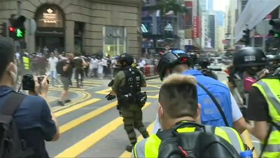 Hong Kong police fire pepper ball rounds at protesters