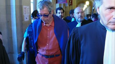 Patrick Balkany leaves court after being sentenced to five years in prison